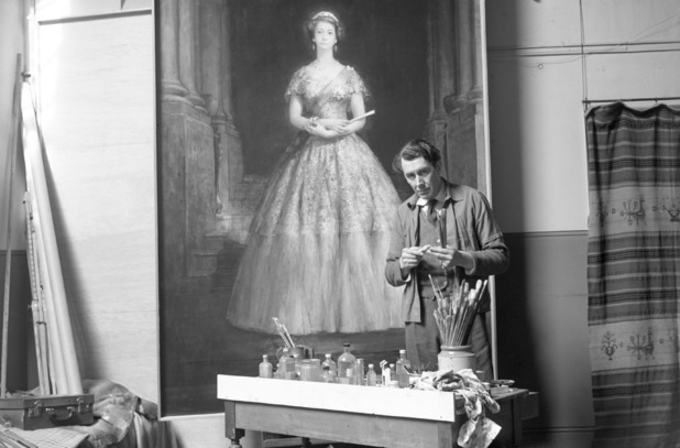 John Napper in his studio based in Chelsea, London, with his life-size portrait of the Queen, which was commissioned for Liverpool Town Hall