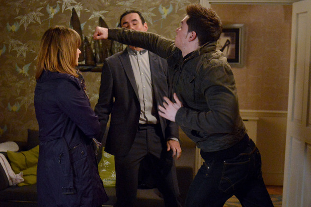 Joey Branning punches Michael Moon