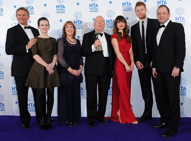 Cast and crew from Downton Abbey with their Best Drama Award, in the press room at the 2013 National Television Awards at the O2 Arena, London.