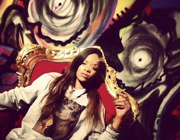 Rihanna poses on a throne in Chris Brown's house