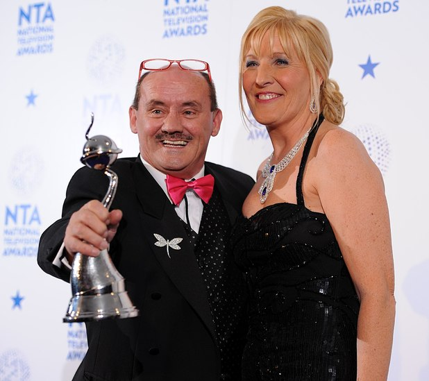Brendan O'Carroll and his wife Jennifer Gibney with the Best Situation Comedy Award for Mrs Brown's Boys, in the press room at the 2013 National Television Awards at the O2 Arena, London.