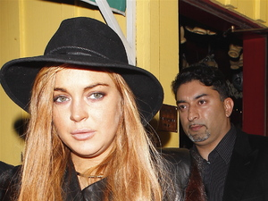 Lindsay Lohan leaving Dan Tana&#39;s restaurant after having dinner with her lawyer Mark Heller