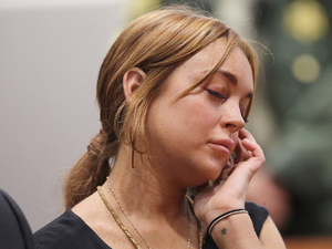 Lindsay Lohan inside a Los Angeles court during her car crash case pretrial hearing Featuring: Lindsay Lohan,Dina Lohan Where: Los Angeles, California, United States When: 30 Jan 2013