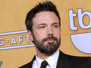 "Ben Affleck poses backstage with the award for best cast in a motion picture for ""Argo"" in the press room at the 19th Annual Screen Actors Guild (SAG) Awards"