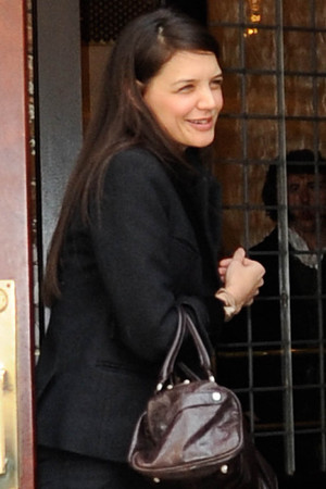Katie Holmes heads to a meeting in a downtown hotel.