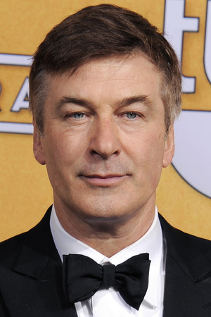 Alec Baldwin poses backstage with the award for best make actor in a comedy series in the press room at the 19th Annual Screen Actors Guild (SAG) Awards
