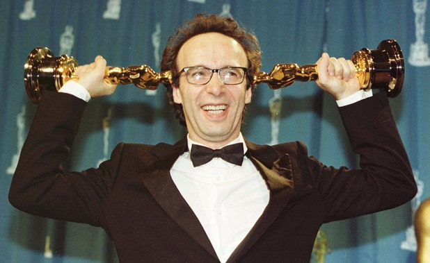 Roberto Benigni with his two oscars which he won at the 71st annual Academy Awards for Best Actor and Best Foreign Film for his film Life is Beautiful - 1999