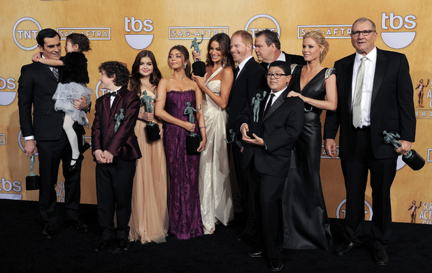 The cast of Modern Family pose with their awards in the press room at the 19th Annual Screen Actors Guild (SAG) Awards