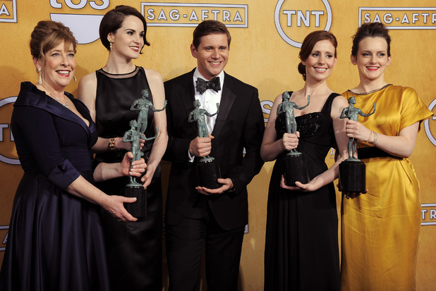 Phyllis Logan, Michelle Dockery, Allen Leech, Amy Nuttall and Sophie McShera pose backstage with the award for best ensemble in a drama series for 'Downton Abbey' in the press room at the 19th Annual Screen Actors Guild (SAG) Awards