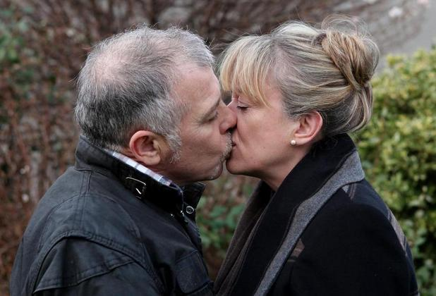 Luke and Judith share a kiss.