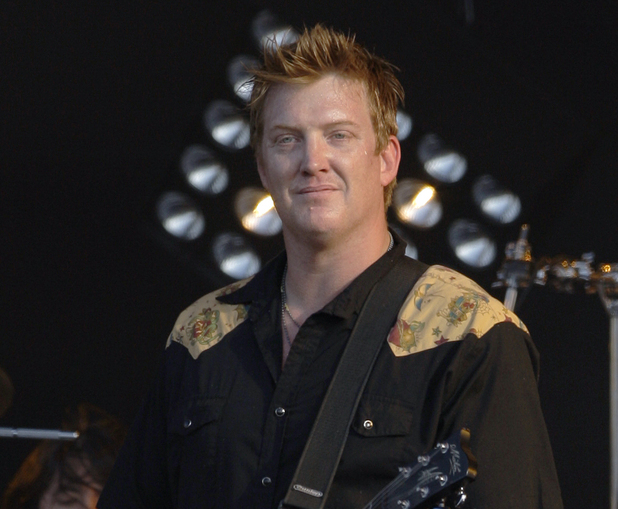 Josh Homme (with Dave Grohl in the background) perform as Them Crooked Vultures at Download 2010