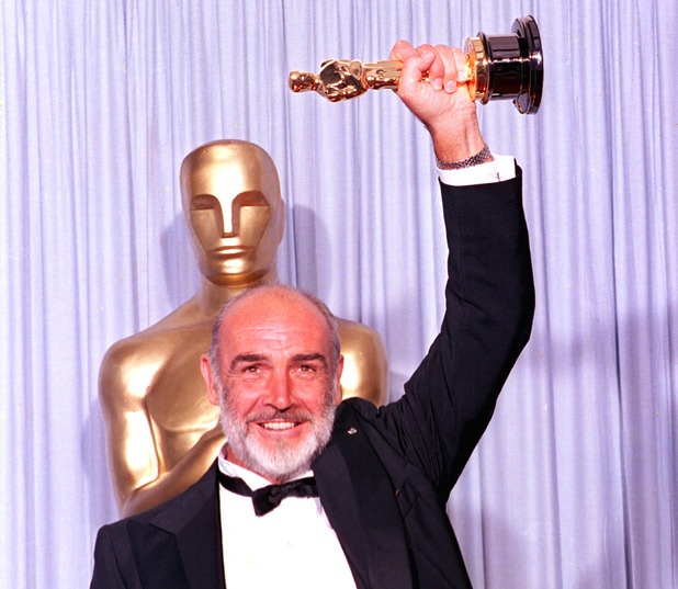Sean Connery holds his first Oscar statuette at the 60th annual Academy Awards in Los Angeles, Ca., April 11, 1988.