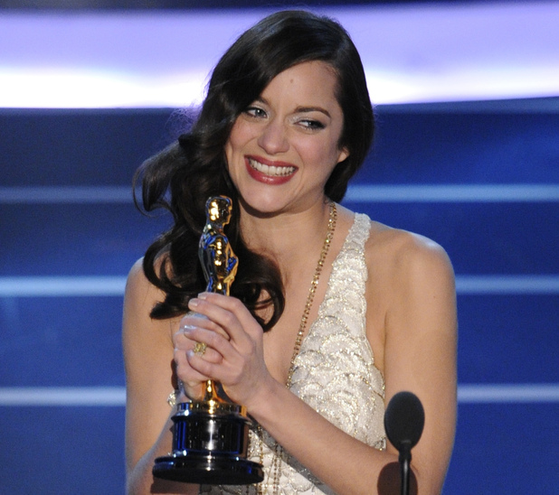 "Marion Cotillard accepts the Oscar for best actress for her work in ""La Vie en Rose"" the 80th Academy Awards Sunday, Feb. 24, 2008, in Los Angeles."