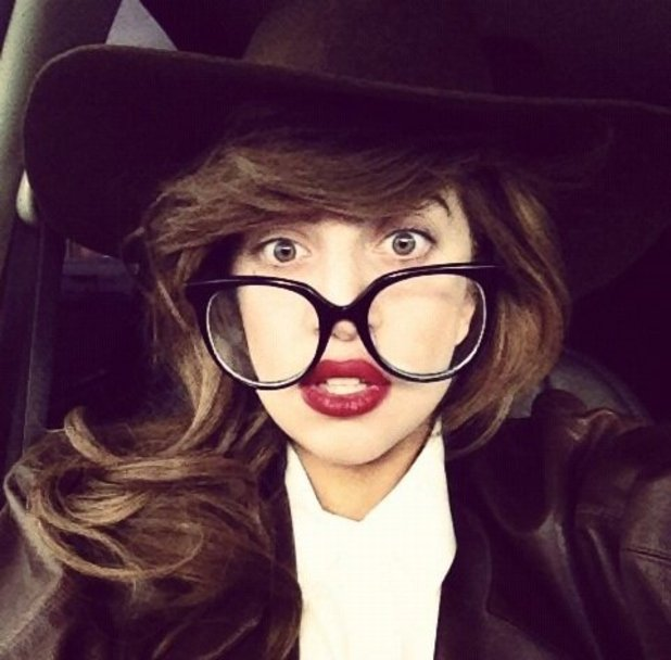 Lady Gaga dresses down in smart outfit and geek glasses