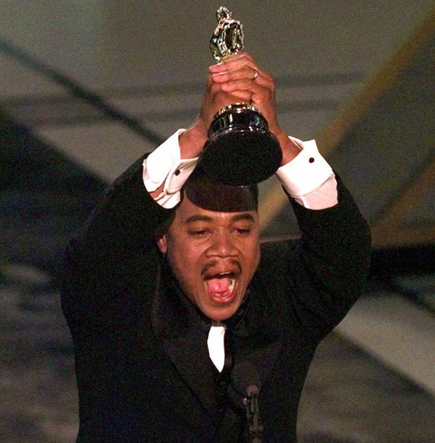 "Cuba Gooding Jr., reacts while accepting the award for Best Supporting Actor for ""Jerry Maguire,"" at the 69th Annual Academy Awards at the Shrine Auditorium in Los Angeles, Monday, March 24, 1997"