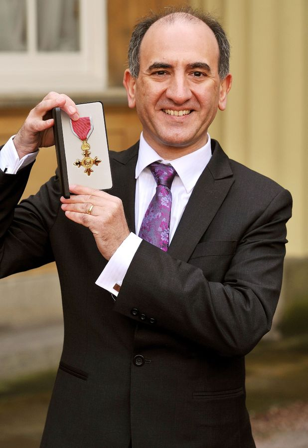 The Prince of Wales presents Armando Iannucci with his Officer of the British Empire (OBE) medal during an Investiture Ceremony at Buckingham Palace in central London.