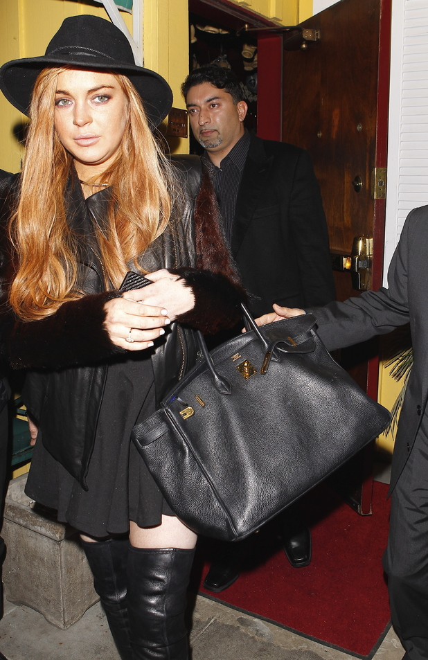 Lindsay Lohan leaving Dan Tana's restaurant after having dinner with her lawyer Mark Heller