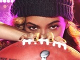 Beyoncé poses with football to promote her upcoming Super Bowl performance