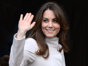 The Duchess of Cambridge waves as she visits the Guildhall and City Centre of Cambridge.