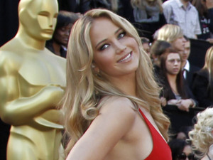 Oscars red carpet: Jennifer Lawrence in a red Calvin Klein dress at the 2011 Academy Awards