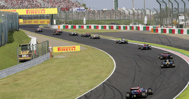 Cars make their way around the circuit behind the safety car following a crash at the start of the Japanese Formula One Grand Prix at the Suzuka Circuit in Suzuka
