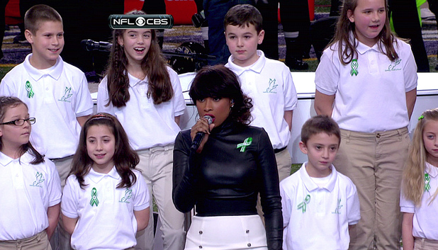 "Jennifer Hudson, along with students from Sandy Hook elementary school chorus, perform ""America the Beautiful"" during Super Bowl XLVII, held at Mercedes-Benz Superdome in New Orleans, Louisiana."
