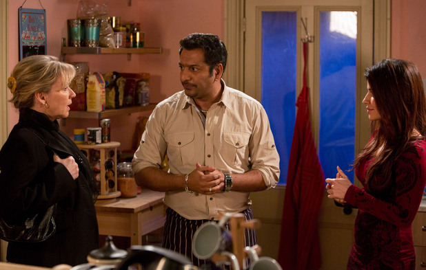 Masood and Ayesha are interrupted by Carol.
