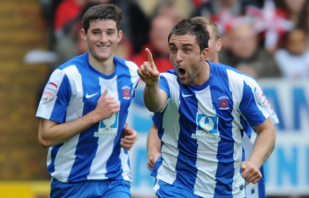 Hartlepool's Peter Hartley (right) celebrates scoring the first goal during the npower League One match at The Valley, London
