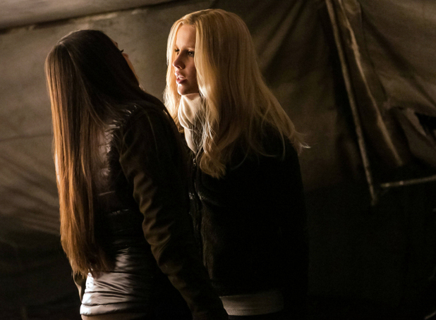 Nina Dobrev as Elena (back to camera) and Claire Holt as Rebekah in The Vampire Diaries S04E13 ('Into The Wild')