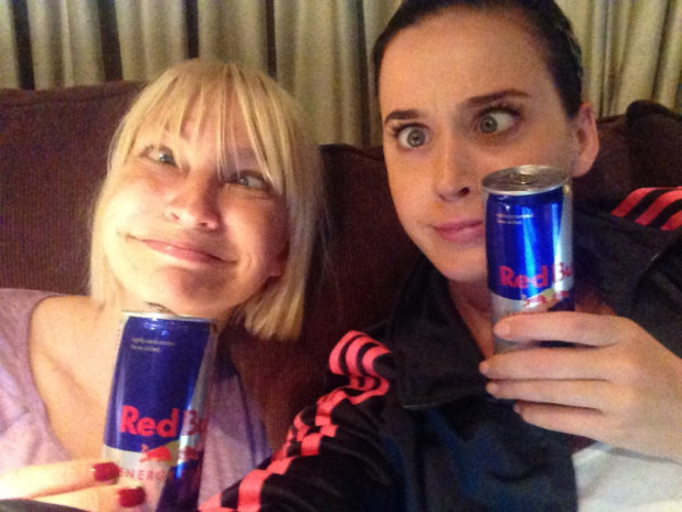 Katy Perry and Sia drink Red Bull in the recording studio.
