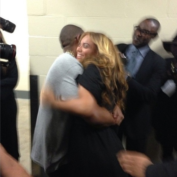 Beyoncé and Jay-Z hug after the former's performance at the Super Bowl half time show.