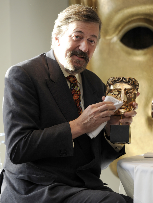 BAFTA Awards host Stephen Fry polishes the awards to be given at the upcoming ceremony, London.