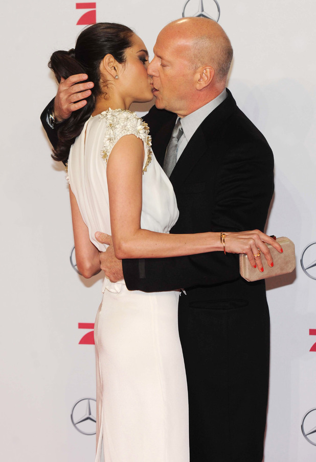 Emma Heming and Bruce Willis kiss