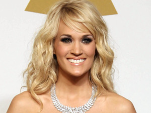 Carrie Underwood poses backstage with the award for best country solo performance for 'Blown Away' at the 55th Annual Grammy Awards