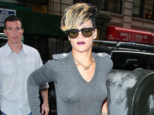 Rihanna arrives at a SoHo building in style, wearing a dark plum lipstick and thigh high boots New York City, USA