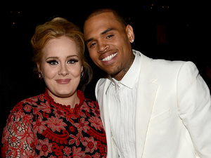 Adele and Chris Brown pictured together at the 55th Annual Grammy Awards