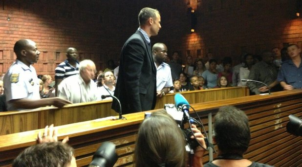 Oscar Pistorius leaves court in Pretoria after being charged with premeditated murder