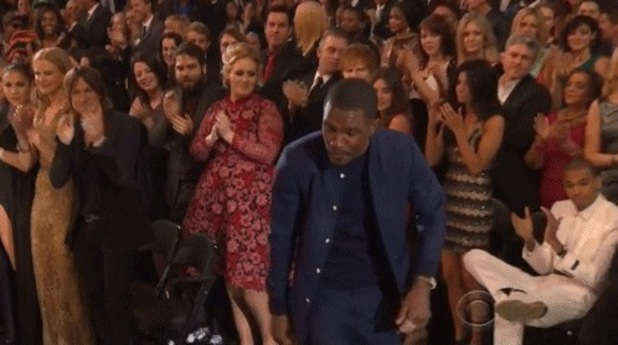 Adele looks over at Chris Brown, who fails to stand when Frank Ocean gets a standing ovation.
