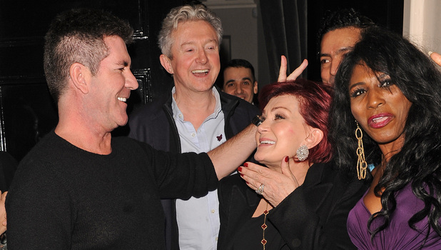 Simon Cowell and Louis Walsh share jokes and a smoke outside the Arts club as they enjoy night out with Simons ex-girlfriend and Sharon OsbourneFeaturing: Simon Cowell,Sharon Osbourne Where: London, United Kingdom When: 15 Feb 2013 Credit: Craig Harris/WENN.com