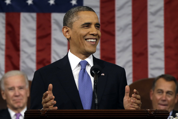President Barack Obama, flanked by Vice President John Biden and House Speaker John Boehner smiles as he gives his State of the Union address during a joint session of Congress on Capitol Hill in Washington, Tuesday Feb. 12, 2013.