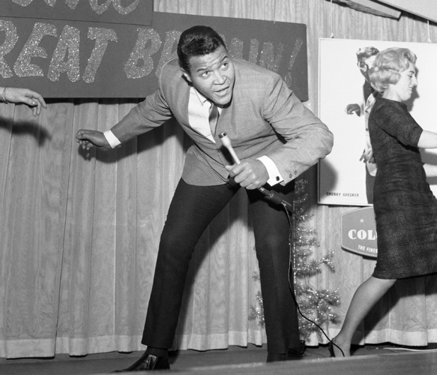 "Chubby Checker, the 20-year-old entertainer from Philadelphia who started the ""Twist"" craze, pictured dancing during a press reception in London, England on Dec. 14, 1961. Chubby is in London for radio and television appearances"