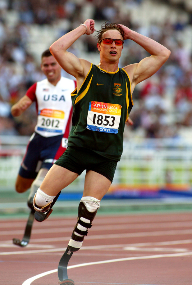 South Africa's Oscar Pistorius races ahead to win the Men's T44 200 metres final