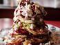 10-inch tower comes with toppings of bacon, raspberries, peanut butter and whipped cream.