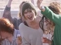 Swift apparently dresses as the One Direction star in video shoot photos.