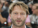 Thomas Kretschmann will play a major villain in the superhero sequel.