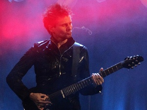 Matt Bellamy of Muse performs during the 2013 Brit Awards at the O2 Arena, London