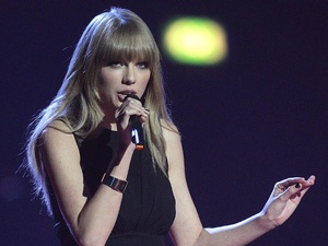 Taylor Swift presents the Best British Female award during the 2013 Brit Awards at the O2 Arena, London.