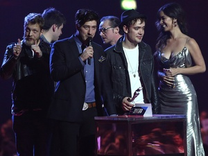 Mumford and Sons collect the award for British group during the 2013 Brit Awards at the O2 Arena, London.