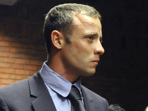 Oscar Pistorius stands following his bail hearing in Pretoria