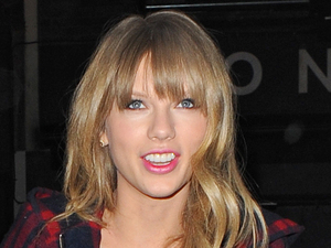 Taylor Swift arrives at Groucho Club with a male companion